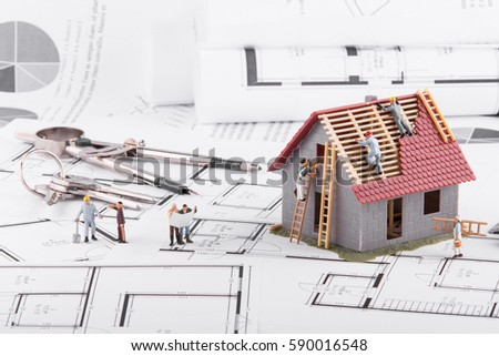 Tiny House Stands On Coins Concept Stock Photo 590016551