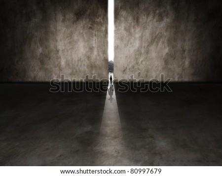 tiny person walking through a gap - stock photo