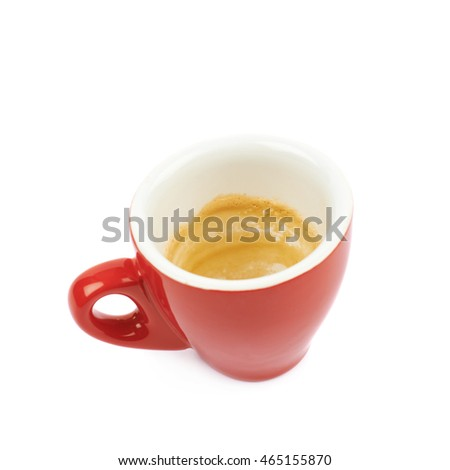 Tiny red finished espresso cup with the coffee leftovers isolated over the white background