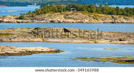 Tiny red granite islands in Aland Islands archipelago, Finland.
