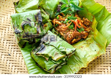 Tiny shrimp curry of grilled food wrapped in leaves, Thailand.