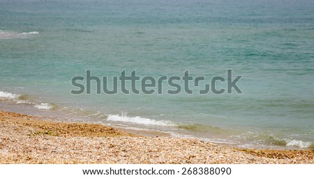 Tiny wave breaking on the shore of the Mediterranean sea - stock photo