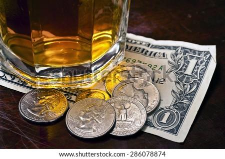 Tip money left on counter/ Tip Money Left On Counter - stock photo