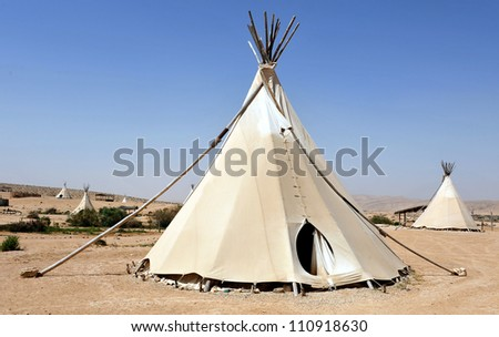 Tipi teepee or tepee - Indian tent in the desert. - stock photo