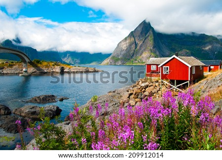 Tipical red fishing houses in a Harbor on Lofoten islands, Norway - stock photo