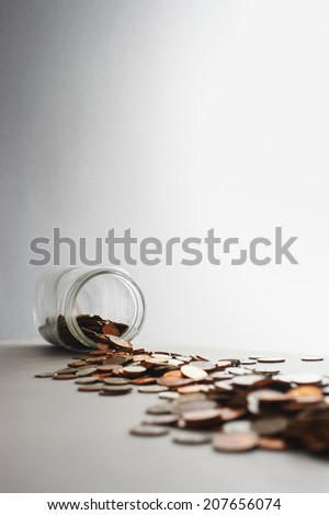 Tipped Coin Jar - stock photo