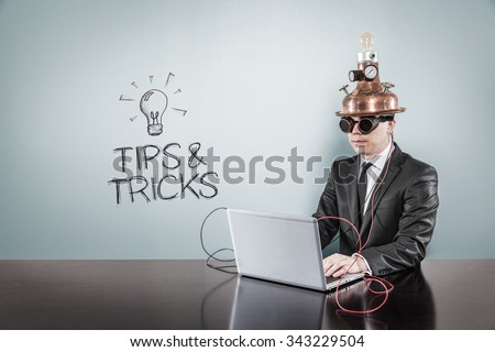 Tips and tricks concept with vintage businessman and laptop at office - stock photo