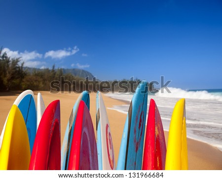 TIps of surf board or surfboards at Lumahai beach in Kauai Hawaii on sandy shore by ocean - stock photo
