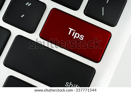 Tips red keyboard button - financial, business, online and data concept
