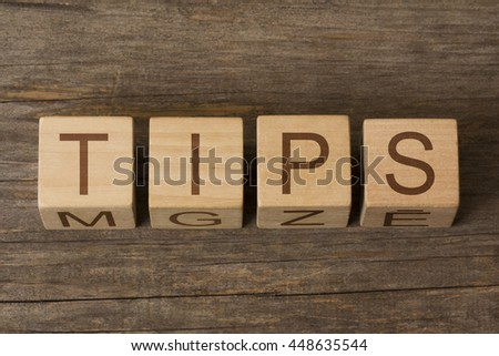 TIPS word written on wooden cubes - stock photo
