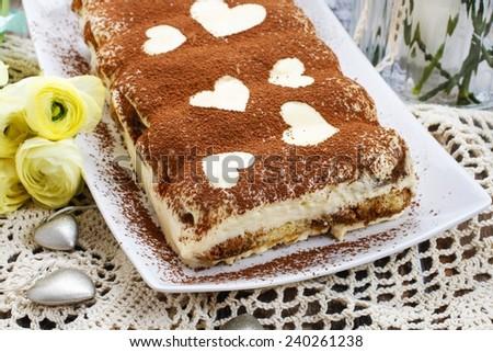 Tiramisu cake decorated with hearts - stock photo