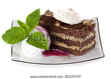 Tiramisu cake on plate with ice cream isolated over white - stock photo