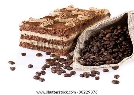 Tiramisu cake with bag of coffee beans isolated over white - stock photo