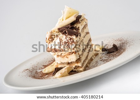 Tiramisu cake with white and dark chocolate flakes