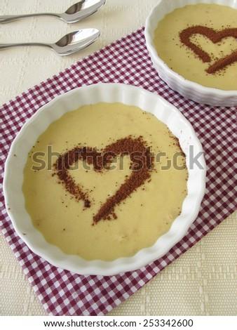 Tiramisu cream with a heart from cocoa powder - stock photo