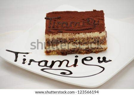 Tiramisu dessert on white plate - stock photo