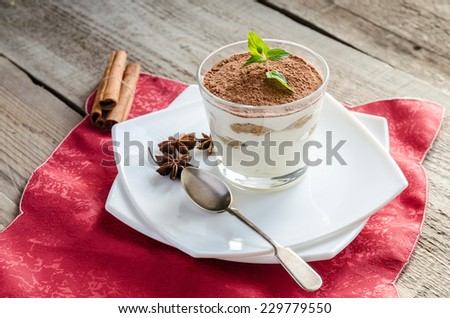 Tiramisu in the glass on the wooden background - stock photo