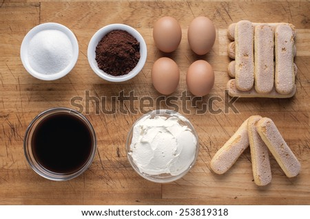 Tiramisu ingredients concept Close up Indoor shot on a wodden board in bird's-eye view - stock photo