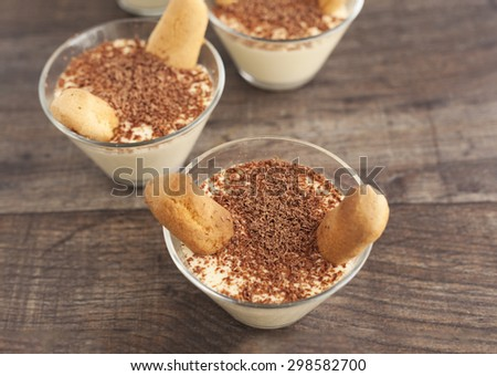 Tiramisu, Italian dessert, in dessert serving glasses. - stock photo