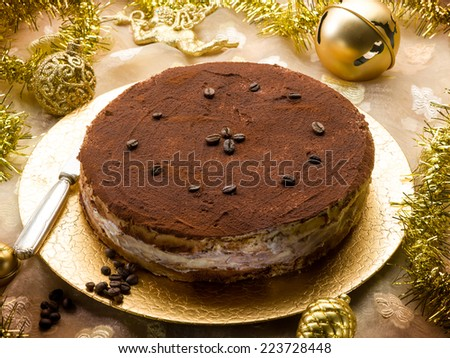 tiramisu over golden christmas table - stock photo
