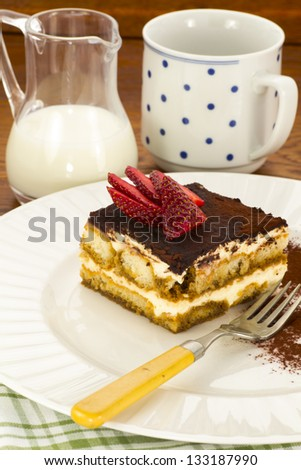 Tiramisu with strawberries sprinkled with cocoa - stock photo