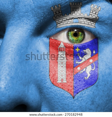 Tirana flag painted on a man's face to support his city Tirana - stock photo