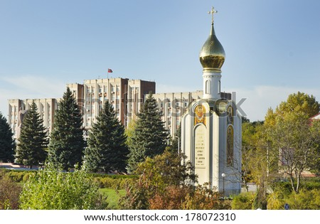 TIRASPOL, TRANSNISTRIA - OCTOBER 20: church and parliament building on October 20, 2013 in Tiraspol, Transistria. Transnistria is a self governing territory not recognised by the United Nations. - stock photo
