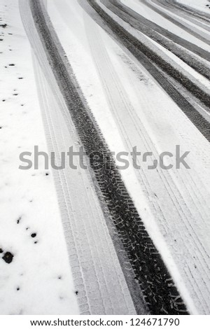 Tire marks (tracks) in the snow - stock photo