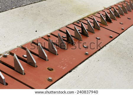 Tire puncture spike strip - stock photo