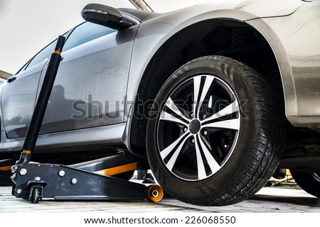 Tire replacement service, fitting with balancing, change to winter - stock photo