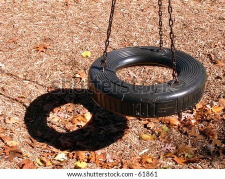 tire swing - stock photo