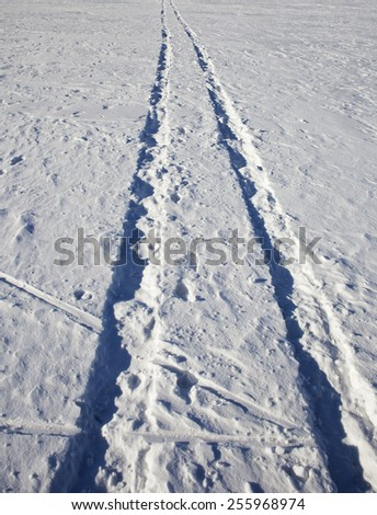 Tire trace on snow. - stock photo