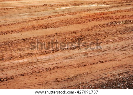 tire track on dirt in construction area