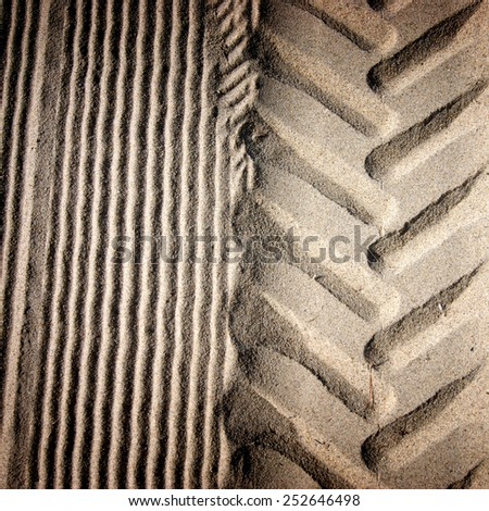 tire tracks in beach sand background texture - stock photo