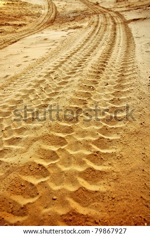 tire tracks in sand - stock photo