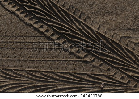 Tire Tracks in Sand  (Close up) - stock photo