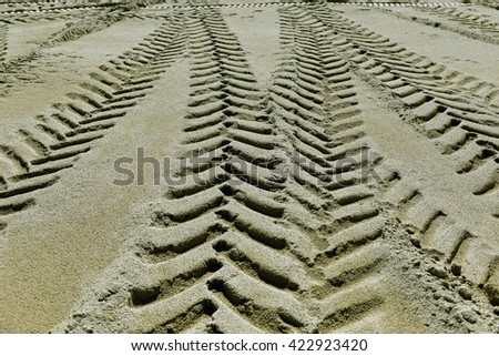tire tracks in the sand as background - stock photo