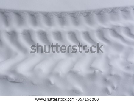Tire tracks on snow. Background and texture. - stock photo