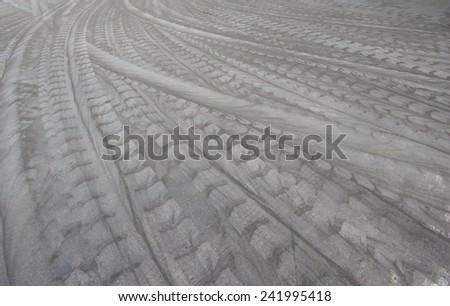 Tire tracks on the cement floor - stock photo