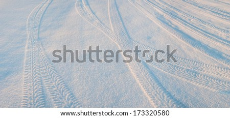 Tire tracks on the snow, winter scene