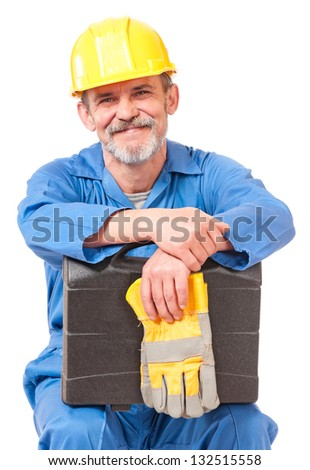 Tired adult worker with toolbox has a rest sitting over white background - stock photo