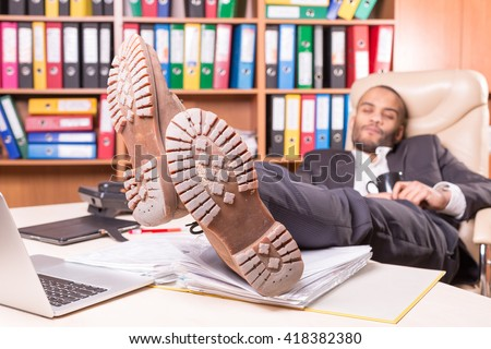 tired african man sleeping in the office - stock photo