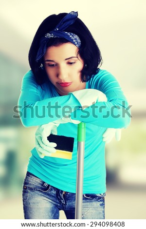 Tired and exhausted cleaning woman - stock photo
