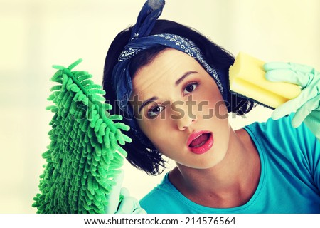 Tired and exhausted cleaning woman portrait - stock photo