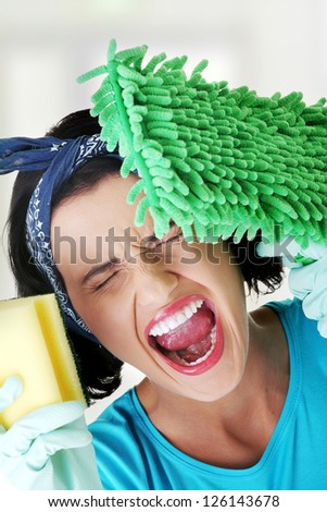 Tired and exhausted cleaning woman screaming - stock photo