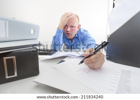 Tired and exhausted office worker - stock photo