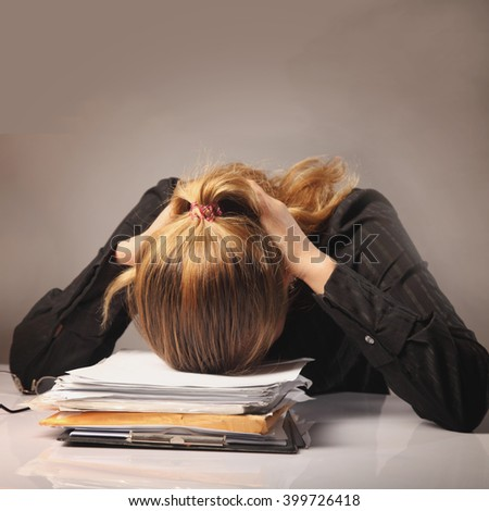 tired and exhausted   woman working with documents (psychological portrait, aggression, anger, frustration) - stock photo