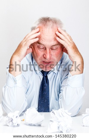Tired and exhousted businessman in office - stock photo