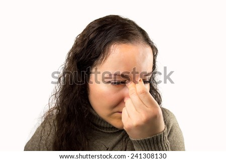 tired and eyestrain woman with white background - stock photo
