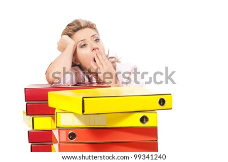 Tired  and sleepy / Business woman behind the stack of folders yawning - stock photo